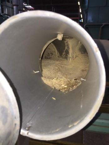 Figuur 3: ophoping van poeder in leidingwerk