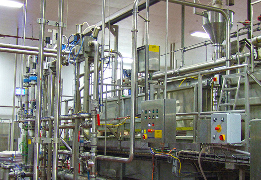 Large_a-round-the-corner-spiroflow-aero-mechanical-conveyor-loads-ingredients-into-mixers-for-butchers-pet-care.